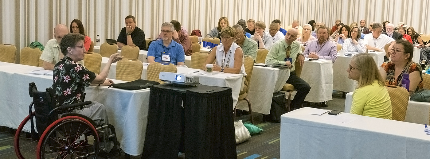 Group of people receiving ADA training at conference.