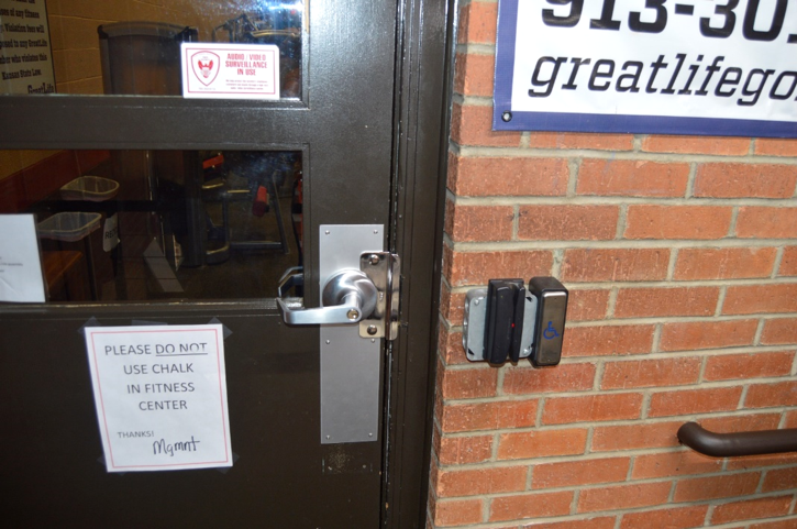 Key card reader for access to exterior door is on the wall next to the door handle.