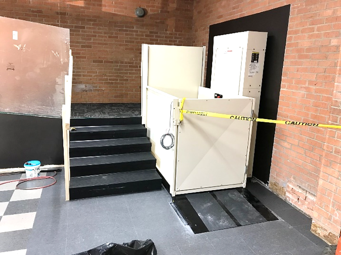 Platform lift turned so mechanical part is next to wall not the stairs.