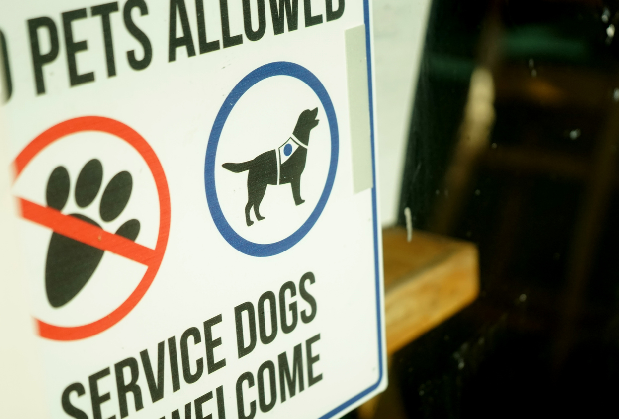 "Sign on door stating ""No Pets"" ""Service Dogs Welcome""."